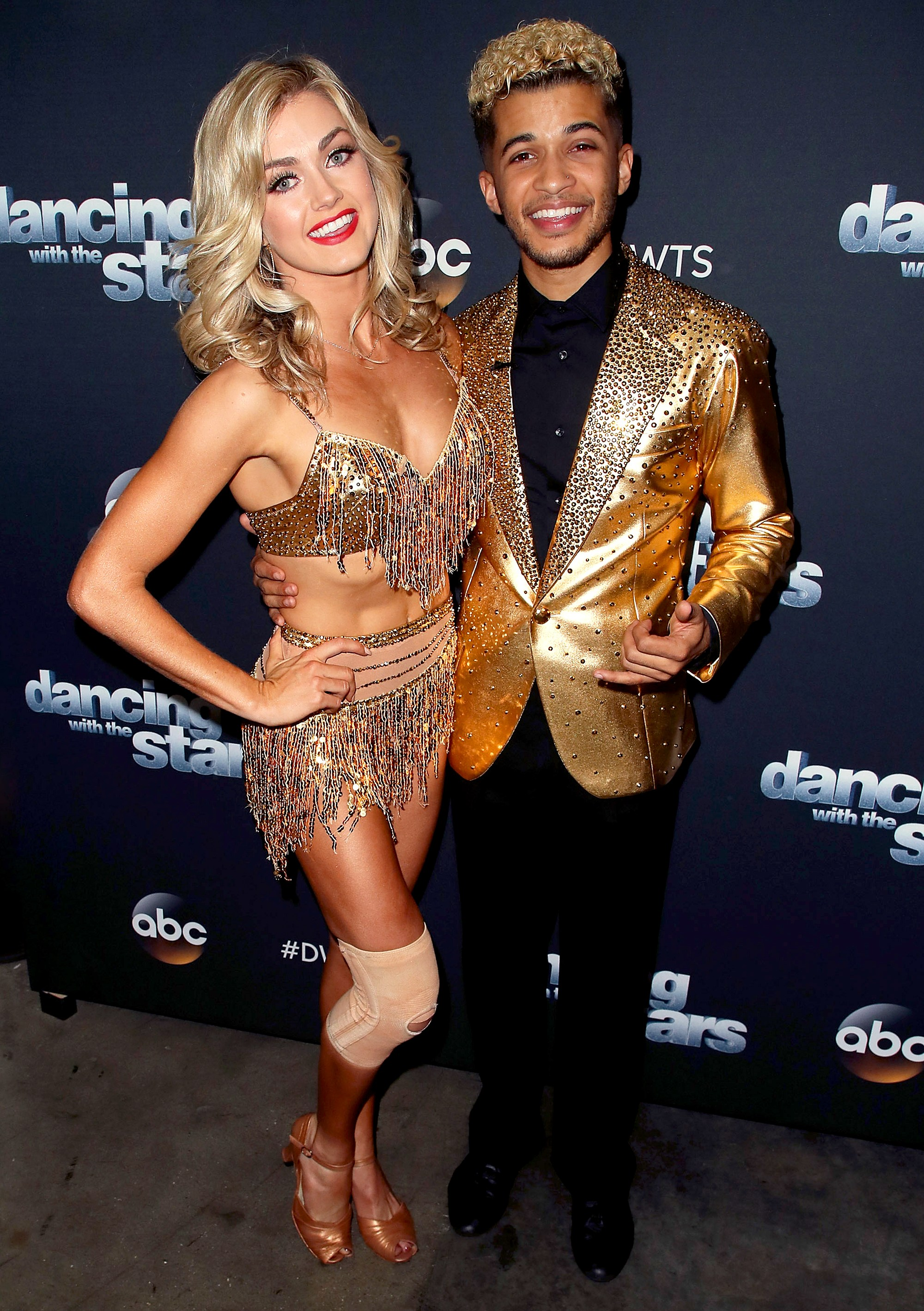 Jordan Fisher and Lindsay Arnold pose at Dancing with the Stars season 25 at CBS Televison City on November 13, 2017 in Los Angeles, California.