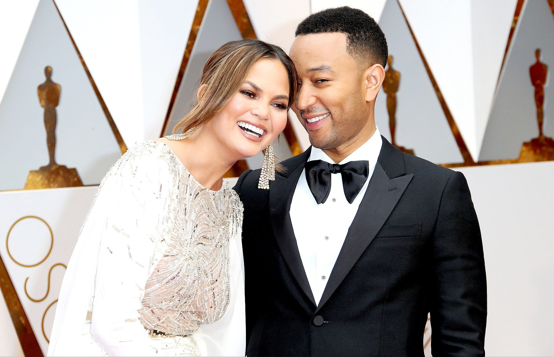Chrissy Teigen and John Legend arrive at the 89th Annual Academy Awards at Hollywood  Highland Center on February 26, 2017 in Hollywood, California.
