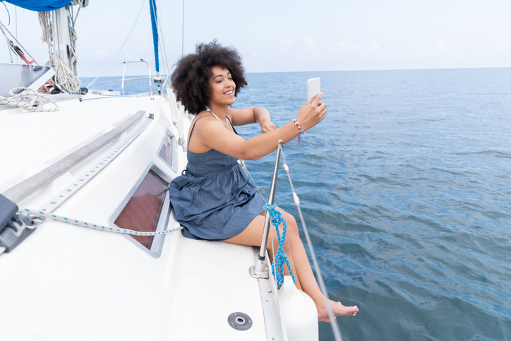 Afro Woman yachtning and taking selfie