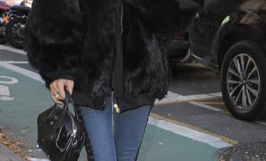 Copy Bella Hadid's Black Fur Coat And Skinny Denim