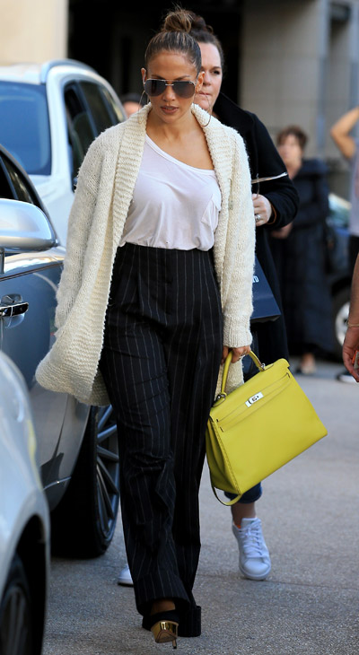 Get Jennifer Lopez' Chic Black Trousers And Cream Knit Sweater Now